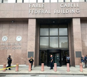 Law enforcement officers secure the scene after a man fired shots outside the Earle Cabell Federal Building in downtown Dalla, Monday, June 17, 2019. (Tom Fox/The Dallas Morning News)