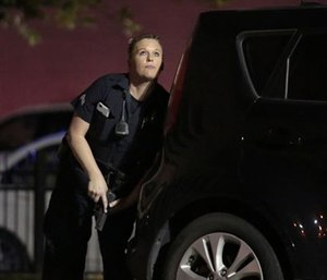 A police officer responding to shots being fired during a protest over recent fatal shootings by police in Louisiana and Minnesota. (Maria R. Olivas/The Dallas Morning News via AP)
