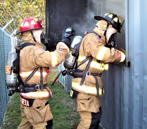 The crew is prepared to enter window prior to venting, masked up and with a practiced plan. The officer is immediately behind search firefighter.