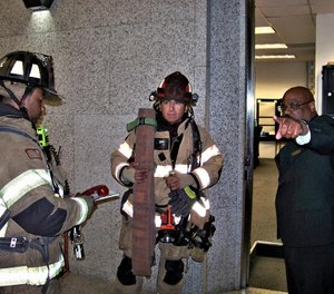 Building personnel can provide valuable information. They can quickly direct firefighters to the elevator lobby or even the correct stairwell based on information they are receiving from other personnel investigating the situation. (Photos/Chris DelBello)