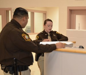 Detailing specific observations, avoiding making assumptionsand writing as clearly as possible will protect you and your facility from unneeded scrutiny. (Photo/CorrectionsOne)