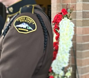 A fellow Pierce County Sheriff's Deputy is pictured at the memorial service for Deputy Daniel McCartney, Jan. 17, 2018. (Photo/Linda Robson)