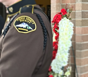 A fellow Pierce County Sheriff's Deputy is pictured at the memorial service for Deputy Daniel McCartney, Jan. 17, 2018.
