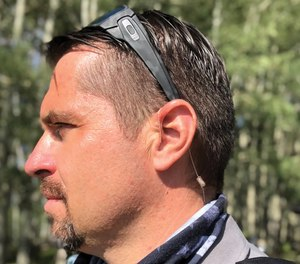 Deputy Siegert models the N-ear 360, which offers comfort, high-quality audio with a barely-visible profile.
