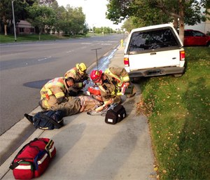 Paramedics attend a diabetic man who lost effective control of his vehicle due to hypoglycemia. (Photo by Sbharris - Wikipedia commons own work, CC BY-SA 3.0)