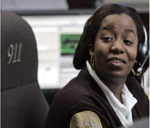 Brunswick County Dispatcher and Chief of Communications Joy Seward man's the desk in her office in Lawrenceville, Va.