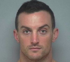 Dominic Socie was arrested after he allegedly walked around a Hilton Head restaurant asking women to show him their IDs.