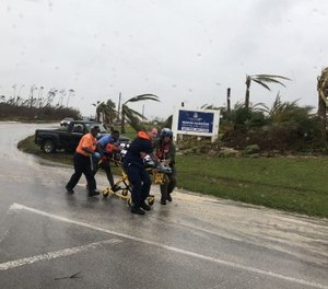 Coast Guard personnel help medevac a patient in the Bahamas during Hurricane Dorian. (Photo/U.S. Coast Guard)