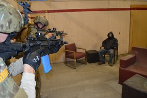It is imperative for drug raid training to incorporate both live fire shoot house training and scenario-based training.