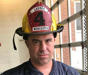 "Worcester EMS paramedic Sean Doherty penned ""December Mourn"" to remember Worcester Fire Department firefighter Christopher Roy."