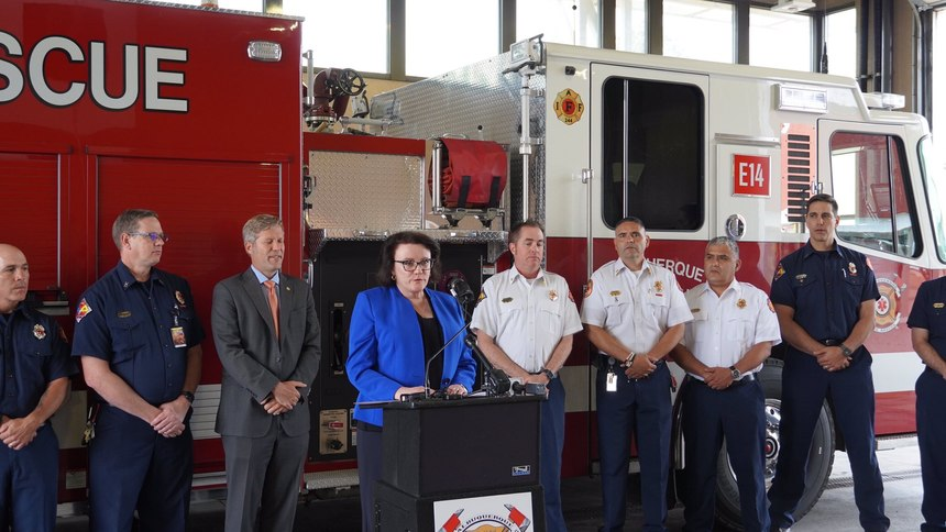 Maia Dalton-Theodore addresses the community from Albuquerque Fire Rescue Department on the day the new behavioral health director position is announced.