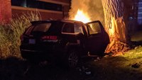 Off-duty border patrol agent uses bowling ball to save man in burning car