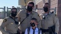 Las Vegas cops escort fallen officer's son, 9, to first day of school