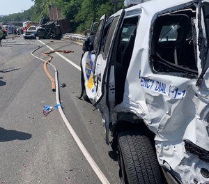 The crash started a chain reaction that left significant damage to an ambulance, fire truck and state police SUVs. (Photo/State Troopers Fraternal Association of NJ)