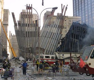 Emergency workers arrive at ground zero after the September 11 terrorist attacks in New York City. (AP Photo/Shawn Baldwin)