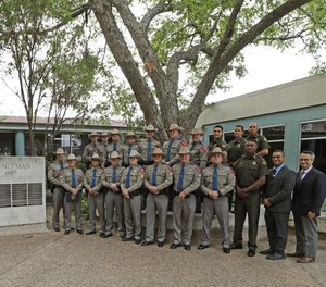 The first-ever Texas DPS Emergency Medical Technician class stands at graduation on Thursday, Sept. 30, in Austin, Texas.
