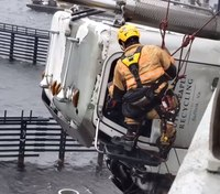 Video: Va. firefighters rescue truck driver suspended 70 feet over river