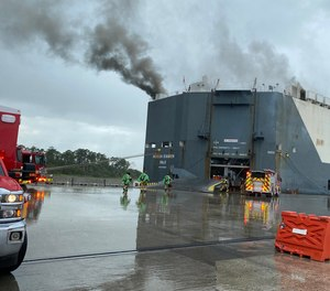 The firefighters were injured in an explosion in an auto hauler ship at Blount Island.