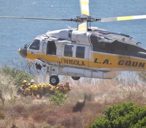 With the increase in wildland fires and the urban interface program allowing structural firefighters greater input into the campaign, fire department personnel can expect to be tasked with providing temporary landing sites.(Photo/LACoFD Twitter)