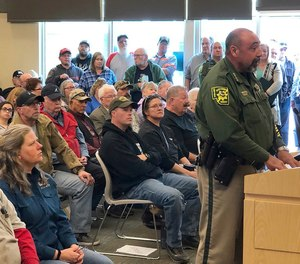 An overflowing crowd packs the Elko County Commission chamber as Elko County Sheriff Aitor Narvaiza presents his case for the county to declare a