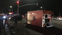 Calif. ambulance flipped on side in collision