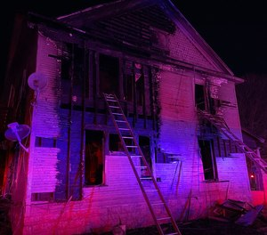 The cause and origin of the fire remain under investigation.