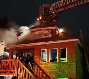 Two Chicago firefighters were injured in a house fire on Monday night.