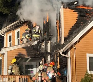 Firefighters from multiple departments battled a blaze at Kingston Fire Chief Graham Pellerin's home Sunday evening.