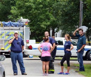 Emergency personnel from Berkeley County stand outside a campground surrounded by police tape near Moncks Corner, S.C., Tuesday, July 7, 2015, after an F-16 fighter jet smashed into a small plane over South Carolina. (Brad Nettles/The Post and Courier via AP)