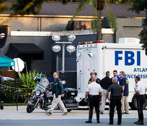 Law enforcement officials investigate shooting at Pulse nightclub.