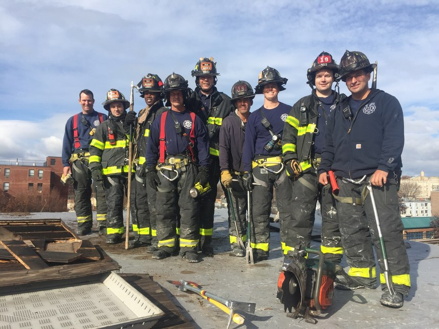 Members of FDNY Engine 50/Ladder 19 after drilling on roof operations.