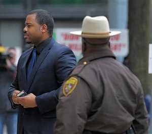 William Porter, left, one of six Baltimore city police officers charged in connection to the death of Freddie Gray, arrives at a courthouse as jury deliberations continue in his trial, Wednesday, Dec. 16, 2015. (AP Image)