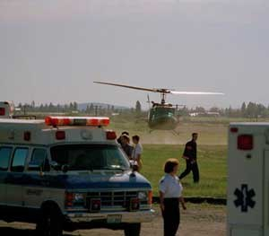 A helicopter carrying a shooting victim takes off from Fairchild Air Force Base in Spokane, Wash., June 20, 1994. A gunman carrying an assault rifle entered the base hospital and opened fire, killing four people and wounding 19 others. The gunman, a serviceman, was killed by military police.