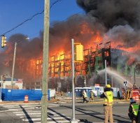 Va. firefighters battle massive fire in under-construction condo building