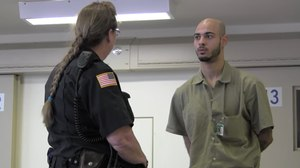 A female corrections officer at Airway Heights Corrections Center speaks with an inmate while on duty. CO Daniele Tavenner was assigned to the facility in April 2019 but resigned just days later due to the alleged harassment she received.