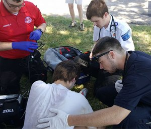 Paramedic students assess a patient during Hutchinson Field Ops program.
