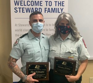 Acadian Ambulance EMT Ryan Wilkenfeld and Paramedic Heather Waites received the agency's Distinguished Service Award for rescuing six people, including a newborn who needed to be resuscitated, after witnessing a major rollover crash in February.