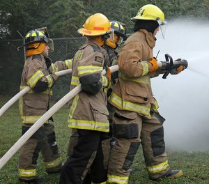 Evaluate team integrity, communication and progress while advancing the hose line to complete a primary search.