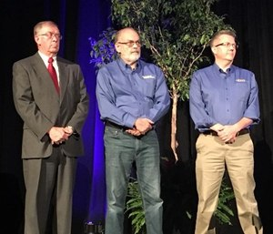 Jack Stout (center) and Todd Stout Founder (right), President of FirstWatch present an award at Pinnacle EMS 2018 to Jon Swanson. (photo/twitter.com/FWDataExperts)