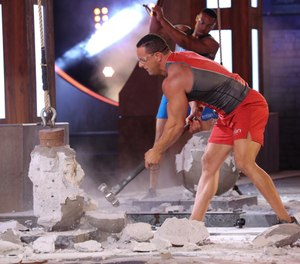 FDNY firefighter Frank Sansonetti competes to win the title of Titan on NBC's