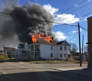 At this fire, an arriving staff officer performing a 360 noticed a sudden failure of a large roof section while the first-in crew was gearing up, and radioed the members about the collapse hazard.