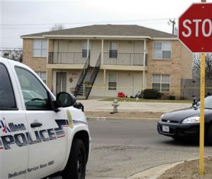 Killeen police investigate the death of a Fort Hood soldier who was found dead at his Killeen, Texas home on Tuesday, Jan. 13, 2015. The first of two Ebola tests given as a precaution came back negative. He had returned from deployment in West Africa. (AP Photo/The Killeen Daily Herald, Eric J. Shelton)