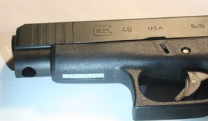 Glock should extend the polymer lower frame toward the muzzle, allowing room for a weapon-mounted light. (Photo/Dick Fairburn)