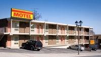 LEO Near Miss: Subject pulls gun during warrant service in motel parking lot