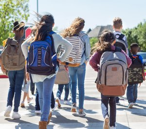 A single, monitored point of entry and screening measures to keep weapons out of schools, plus the presence of a uniformed officer on campus, are key strategies to boost school safety. (image/Getty)