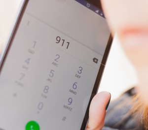 The mayor and former police chief last year discussed plans to outsource the city's dispatchers and the City Council approved a deal with Cook County to assume control of Harvey's 911 system. (Photo/Getty Images)
