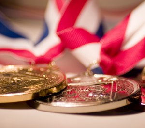 """An Olympian rarely says """"me"""" or """"I""""when discussing theirwinning performance.Instead, they use their moment of triumph to praise the family, coaches andfans who made their success possible."""