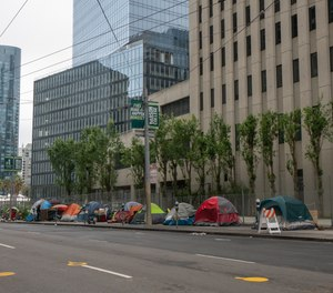 Homeless tents line Main Street in San Francisco's financial district during shelter in place order.