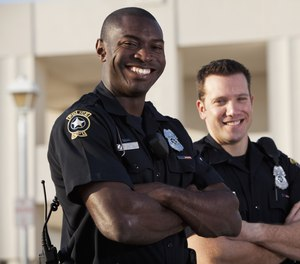 Freeing up time spent reporting means officers gives officers more time to build relationships with the community. (image/Getty)