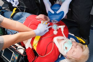 For patients who do not achieve ROSC early in the resuscitation attempt, is it better to stay on scene and continue resuscitation efforts until you obtain ROSC or terminate the attempt, or should you load the patient as soon as you can and transport to the emergency department with CPR in progress?
